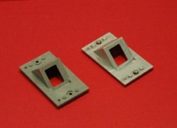 optical hoods—small, wedge-shaped pieces act as eye shields to deflect laser light from optical connectors and other internal components